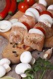 Raw chicken kebabs on wooden skewers vertical Royalty Free Stock Image