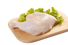 Raw chicken leg. On cutting board Royalty Free Stock Images