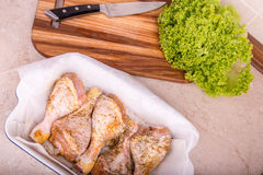 Raw chicken leg on a cutting board Royalty Free Stock Image