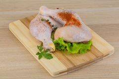 Raw chicken leg. With herbs ready for cooking Royalty Free Stock Photo