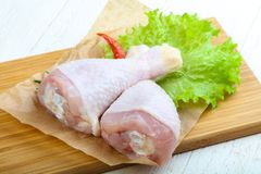 Raw chicken leg. With herbs and spices ready for cooking Stock Photos