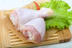 Raw chicken leg. With herbs and spices ready for cooking Stock Photography