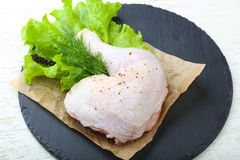 Raw chicken leg. With herbs and spices ready for cooking Stock Image