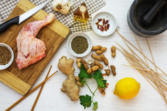 Raw chicken leg with ingredients from above, cooking asian satay Stock Photography
