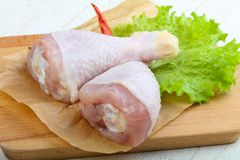 Raw chicken leg. With herbs and spices ready for cooking Royalty Free Stock Photo