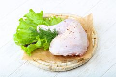 Raw chicken leg. With herbs and spices ready for cooking Stock Photo