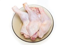 Raw chicken legs Stock Images