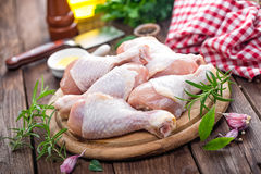 Raw chicken legs. On board Stock Photos