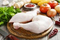 Raw chicken legs. Fresh raw chicken legs on the cutting board Stock Image