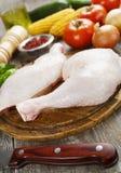 Raw chicken legs. Fresh raw chicken legs on the cutting board Stock Photo