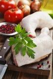 Raw chicken legs. Fresh raw chicken legs on the cutting board Royalty Free Stock Photo