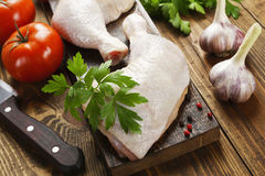 Raw chicken legs. Fresh raw chicken legs on the cutting board Royalty Free Stock Images