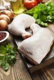 Raw chicken legs. Fresh raw chicken legs on the cutting board Royalty Free Stock Image