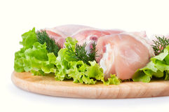 Raw chicken legs with green salad Royalty Free Stock Photos
