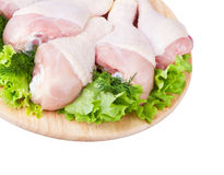 Raw chicken legs with green salad Stock Photography