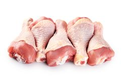 Raw chicken legs isolated on white background. With clipping path Stock Photos