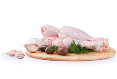 Raw chicken legs with olives Stock Photography