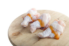 Raw chicken legs with oyster sauce on white background. Raw chicken legs with oyster sauce on wooden cutting boards on white background Stock Images
