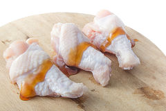 Raw chicken legs with oyster sauce on white background Stock Photo