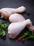 Raw chicken legs with parsley. Selective focus stock image