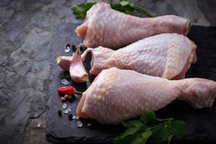 Raw chicken legs with parsley. Selective focus royalty free stock photo