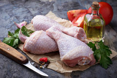 Raw chicken legs with parsley. Selective focus stock photography