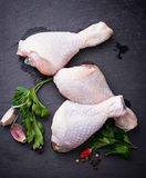 Raw chicken legs with parsley. Selective focus royalty free stock photography