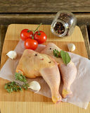 Raw chicken legs with pepper and herbs stock photography