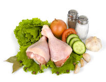 Raw chicken legs with salad Royalty Free Stock Photos