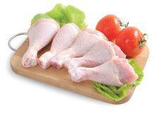 Raw chicken legs - isolated royalty free stock images