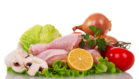 Raw chicken legs and vegetables for cooking isolated on white. Raw chicken legs and vegetables for cooking isolated on white background Stock Photo