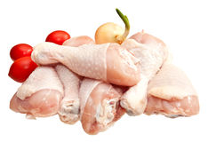 Raw chicken legs with vegetables. Isolated on white background Stock Image