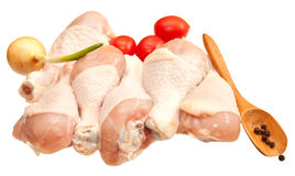 Raw chicken legs with vegetables Stock Image