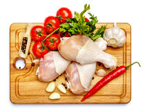 Raw chicken legs on a white background Stock Photos