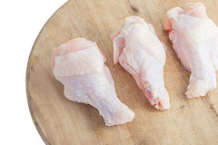 Raw chicken legs on white background. Raw chicken legs on wooden cutting boards on white background Stock Photography