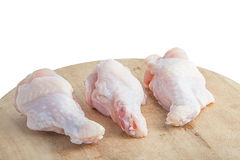 Raw chicken legs on white background. Raw chicken legs on wooden cutting boards on white background Stock Images