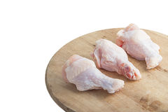 Raw chicken legs on white background. Raw chicken legs on wooden cutting boards on white background Royalty Free Stock Photos