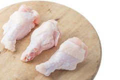 Raw chicken legs on white background. Raw chicken legs on wooden cutting boards on white background Stock Photos