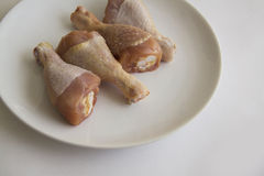 Raw chicken legs only on white plate. Studio shot stock photo