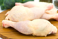Raw chicken legs on the wooden board Stock Images