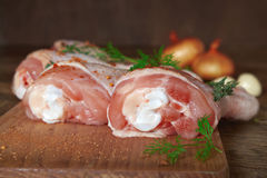 Raw chicken legs on wooden board. Raw chicken legs on cutting board Royalty Free Stock Photos