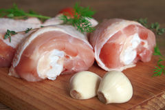 Raw chicken legs on wooden board. Raw chicken legs on cutting board Stock Photos