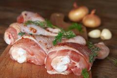 Raw chicken legs on wooden board. Raw chicken legs on cutting board Stock Photo