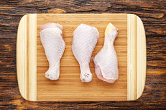 Raw chicken legs. On a wooden board, top view, horizontal photo Royalty Free Stock Photography