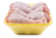 Raw chicken legs in yellow plastic tray Royalty Free Stock Photos