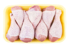 Raw chicken legs in yellow plastic tray Stock Photography