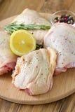 Raw chicken with lemon Stock Photos