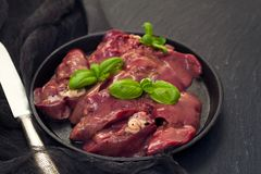 Raw chicken liver with black pepper Stock Image