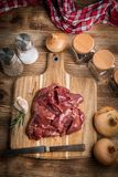 Raw chicken liver on cutting board. Selective focus Stock Photography