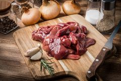 Raw chicken liver on cutting board. Selective focus Stock Images